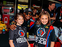 Jun 2, 2018; Joliet, IL, USA; NHRA top fuel driver Antron Brown (center) poses for a photo with young fans during qualifying for the Route 66 Nationals at Route 66 Raceway. Mandatory Credit: Mark J. Rebilas-USA TODAY Sports