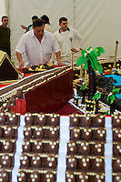 Joaquín Galán, Pastelería Galán owner in Albal, his son, workers and friends assembling the most sweet street circuit.