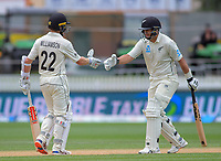 Kane Williamson congratulates Ross Taylor on reaching 7000 career runs during day five of the international cricket 2nd test match between NZ Black Caps and England at Seddon Park in Hamilton, New Zealand on Tuesday, 3 December 2019. Photo: Dave Lintott / lintottphoto.co.nz