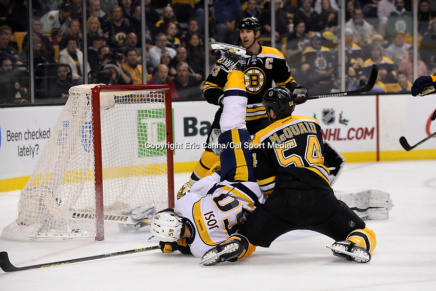 Monday, December 7, 2015: Nashville Predators defenseman Roman Josi (59) trips over Boston Bruins goalie Jonas Gustavsson (50) and defenseman Adam McQuaid (54) while scoring a goal during the National Hockey League game between the Nashville Predators and the Boston Bruins held at TD Garden, in Boston, Massachusetts. The Predators defeat the Bruins 3-2 in regulation time. Eric Canha/CSM