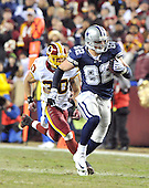 Landover, MD - December 27, 2009 -- Dallas Cowboys tight end Jason Witten (82) is chased by Washington Redskins safety LaRon Landry (30) in second quarter action against the Washington Redskins at FedEx Field in Landover, Maryland on Sunday, December 27, 2009..Credit: Ron Sachs / CNP.(RESTRICTION: NO New York or New Jersey Newspapers or newspapers within a 75 mile radius of New York City)