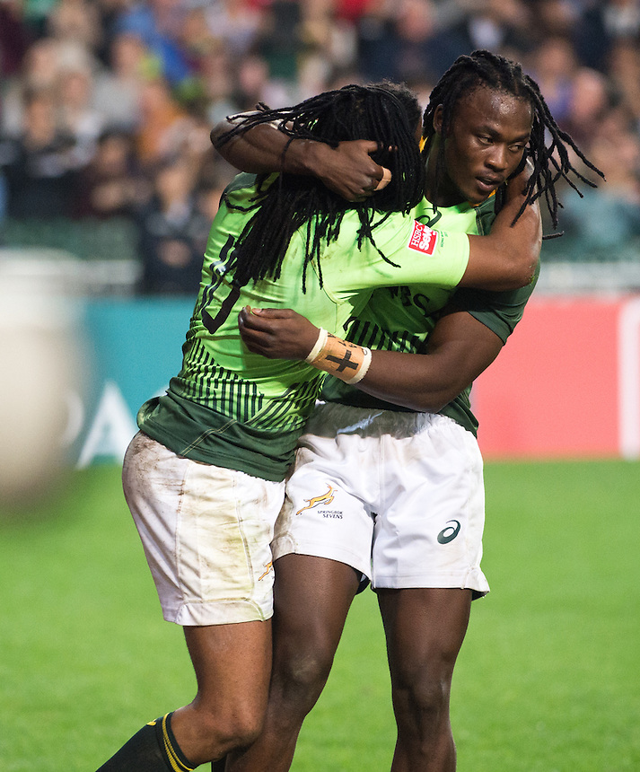 South Africa Vs Argentina.South Africa beat Argentina in the first day of the Hong Kong 7's rugby. Seattle Senatla (11) congratulates Cecil Afrika (Left 10) after his sensational try.27.03.15. 27th March 2015.