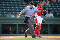 Umpire Blake Carnahan works a game between the Delmarva Shorebirds and the Greenville Drive on Monday, April 29, 2013, at Fluor Field at the West End in Greenville, South Carolina. (Tom Priddy/Four Seam Images)