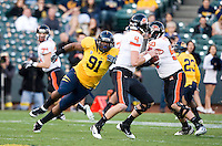 November 12th, 2011:  Deandre Coleman of California pressures Oregon State's Sean Mannion during a game at AT&T Park in San Francisco, Ca  -  California defeated Oregon State 23 - 6