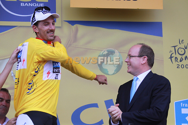 Fabian Cancellara receives the yellow jersey after winning the first stage prologue in the 2009 Tour de France, 4th July 2009 (Photo by Manus OReilly/NEWSFILE)
