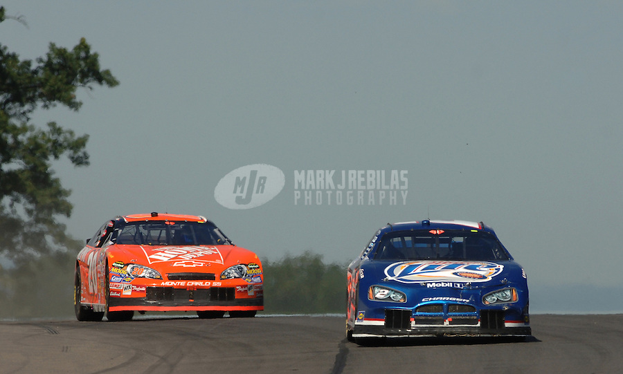 Aug. 13, 2006; Watkins Glen, NY, USA; Nascar Nextel Cup driver Kurt Busch (2) leads Tony Stewart (20) during the AMD at the Glen at Watkins Glen International. Mandatory Credit: Mark J. Rebilas