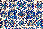 Iznik 13 - Stylized flower and leaf motifs on Iznik tiles in Rustem Pasa Mosque, Eminonu, Istanbul, Turkey