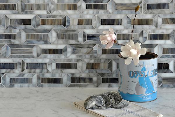 Pandora, a jewel glass mosaic, is shown in Tourmaline and Lavastone.
