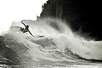A surfer catching a wave in Mirissa, Sri Lanka