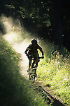 A mountain biker rides dusty singletrack trail in Jackson Hole, Wyoming.