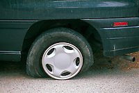 Deflated Flat Tire / Tyre on Car due to Puncture on Road / Highway