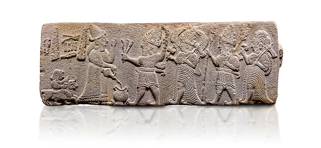 Aslantepe Hittite relief sculpted orthostat stone panel. Limestone, Aslantepe, Malatya, 1200-700 B.C.  Anatolian Civilisations Museum, Ankara, Turkey<br /> <br /> Scene of the king's offering drink and sacrifice to the gods. King pours from the pitcher to the vessel (libation); behind the king is a servant bringing a sacrifice. Storm God across the king holds Teshup, a triple lightning bundle - sickle, and a spear-mace set in the other orthostat; the goddess Ishtar holds weapon in both. All six figures have shoes with the curled ends. <br /> <br /> Against a white background.