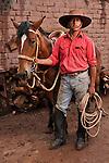 Chilean gaucho with horse near the town of San Pedro de Atacama in the Atacama desert.