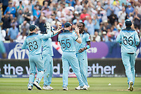 High fives as Jofra Archer (England) celebrates the wicket of Maxwell with team mates during Australia vs England, ICC World Cup Semi-Final Cricket at Edgbaston Stadium on 11th July 2019
