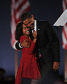 Chicago, IL - November 4, 2008 -- United States President-elect Barak Obama hugs his daughter Malia after speaking in Lower Hutchinson Field, Grant Park, Chicago, Illinois after his election as President of the United States on Tuesday, November 4, 2008..Credit: Ron Sachs / CNP.(Restriction: No New York Metro or other Newspapers within a 75 mile radius of New York City)