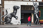 Mural on the wall of Rivington Studios, a 'Creative Office and Events Space' in Shoreditch, London, a run-down commercial district  also known as Silicon Roundabout, which is undergoing gentrification as it becomes a centre for web-based companies and IT start-ups.