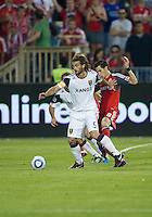 13 August 2011: Real Salt Lake midfielder Kyle Beckerman #5 and Toronto FC Eric Avila #8 in action during a game between Real Salt Lake and Toronto FC at BMO Field in Toronto..Toronto FC won 1-0.