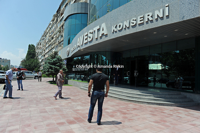 "(Center) Ibrahim Ibrahimov, an Azerbaijani oligarch and billionaire, walks into his office at Avesta Concern on the prestigious Teymur Aliyev Street, known locally as ""the oligarch's street"", in Baku, Azerbaijan on July 18, 2012.  The brainchild of Ibrahimov, the artificial Khazar Islands project just southwest of the Azerbaijani capital Baku is being built at a projected cost of $100 billion with an anticipated 800,000 housing units."