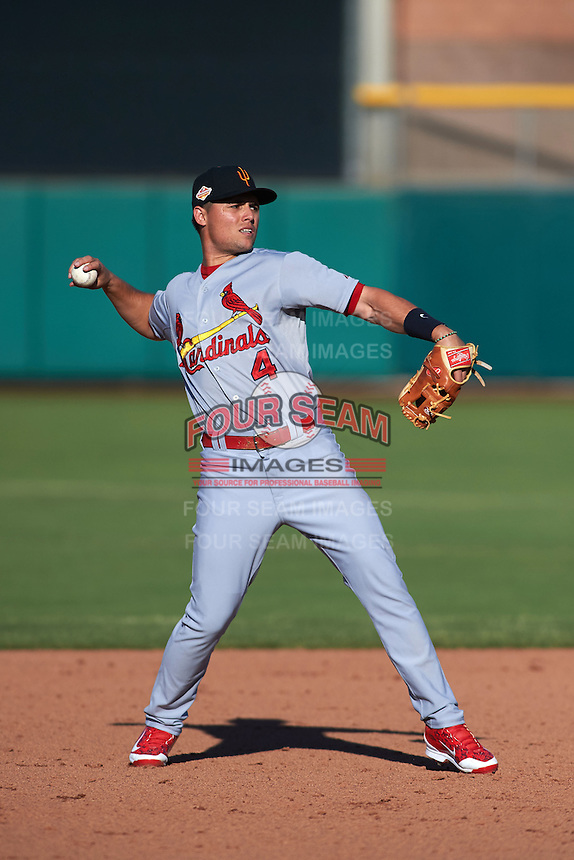 Surprise Saguaros shortstop Aledmys Diaz (4) warmup throw to first during an Arizona Fall League game against the Scottsdale Scorpions on October 22, 2015 at Scottsdale Stadium in Scottsdale, Arizona.  Surprise defeated Scottsdale 7-6.  (Mike Janes/Four Seam Images)
