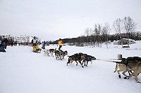 Conway Seavey and dog team leaves the start line of the 2013 Junior Iditarod on Knik Lake.  Knik Alaska..Photo by Jeff Schultz/IditarodPhotos.com   Reproduction prohibited without written permission
