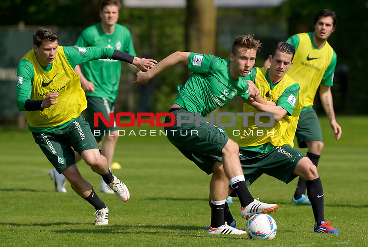 01.05.2012, Trainingsgelaende, Bremen, GER, 1.FBL, Training Werder Bremen, im Bild Sebastian Boenisch (Bremen #2), Tom Trybull (Bremen #25), Aleksandar Stevanovic (Bremen #34)<br /> <br /> // during training session of Werder Bremen on 2012/05/01, Trainingsgelaende, Bremen, Germany.<br /> Foto &copy; nph / Frisch *** Local Caption ***