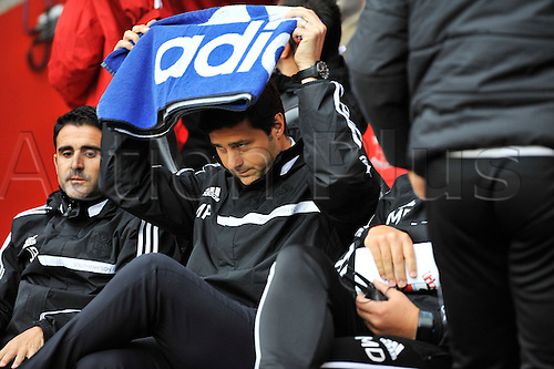 15.09.2013 Southampton, England.    Mauricio Pochettino manager of Southampton shelters from the rain during the Premier League game between Southampton and West Ham United from St Mary's Stadium.