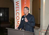 Ethan Caldwell '90<br /> Now in his 30th year as Oxy's head men's basketball coach, Brian Newhall received a much deserved celebration with a surprise halftime ceremony and post game reception in the Booth Hall courtyard with more than 70 former and current players from all different generations and decades in attendance, on Saturday, Jan. 26, 2019.<br /> Newhall is the winningest coach in Oxy history and has a 100 percent graduation rate in his 30 years at the helm of the program. His resume boasts multiple SCIAC Championships and NCAA Playoff appearances, along with a run to the NCAA Division III Elite Eight in 2003 and the only perfect 14-0 season in SCIAC history. Newhall has not only coached at Oxy, but was a SCIAC Champion and SCIAC Player of the Year during his playing career at Oxy in the early 80s.<br /> (Photo by Marc Campos, Occidental College Photographer)