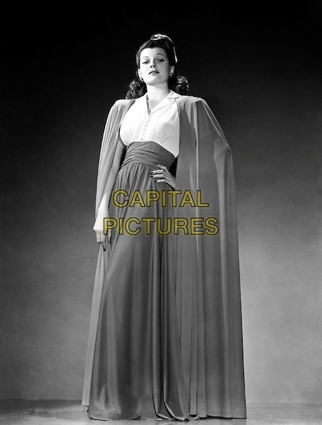 Rita Hayworth, 1941: American film actress Rita Hayworth (1918 - 1987) wearing a long skirt with a matching cloak. .*Filmstill - Editorial Use Only*.CAP/PLF.Supplied by Capital Pictures.