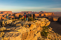 Photography workshop group and morning light on famous formations from Hunts Mesa, Monument Valley Tribal Park, Arizona