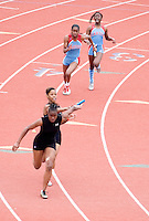 The baton is passed by the Skyline High School and Carter High School girls relay teams in the Girls 4X200 Meter Relay during the Eddie Payne Relays track and field event at John E. Kincaide Stadium in Dallas, Texas, Saturday, March 29, 2008...MATT NAGER/ SPECIAL CONTRIBUTER