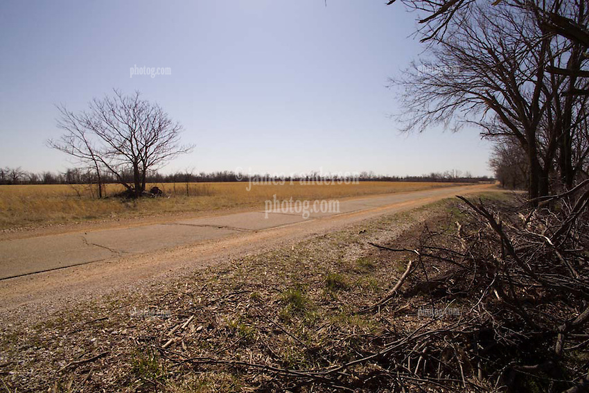 """Old US Route 66 south of Miami Oklahoma. Original alignment consisting of Portland Cement just 8 feet wide here, sometimes refered to as """"Sidewalk Highway"""". Location:  E St SW, South of E 120 Rd before turning right onto E 130 Rd. View Southeast."""