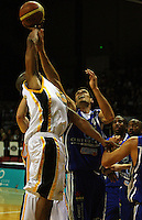 Link Adams rises above Arthur Trousdell during the NBL Basketball match between Wellington Saints and Devon Dynamos Taranaki at TSB Bank Arena, Wellington, New Zealand on Friday, 11 April 2008. Photo: Dave Lintott / lintottphoto.co.nz