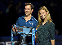 Mike Bryan and girlfriend Nadia Murgasova posing with the trophy he and Jack Sock won  against Pierre-Hughes Herbert and Nicolas Mahut in their doubles Final match today<br /> <br /> Photographer Hannah Fountain/CameraSport<br /> <br /> International Tennis - Nitto ATP World Tour Finals Day 8 - O2 Arena - London - Sunday 18th November 2018<br /> <br /> World Copyright &copy; 2018 CameraSport. All rights reserved. 43 Linden Ave. Countesthorpe. Leicester. England. LE8 5PG - Tel: +44 (0) 116 277 4147 - admin@camerasport.com - www.camerasport.com