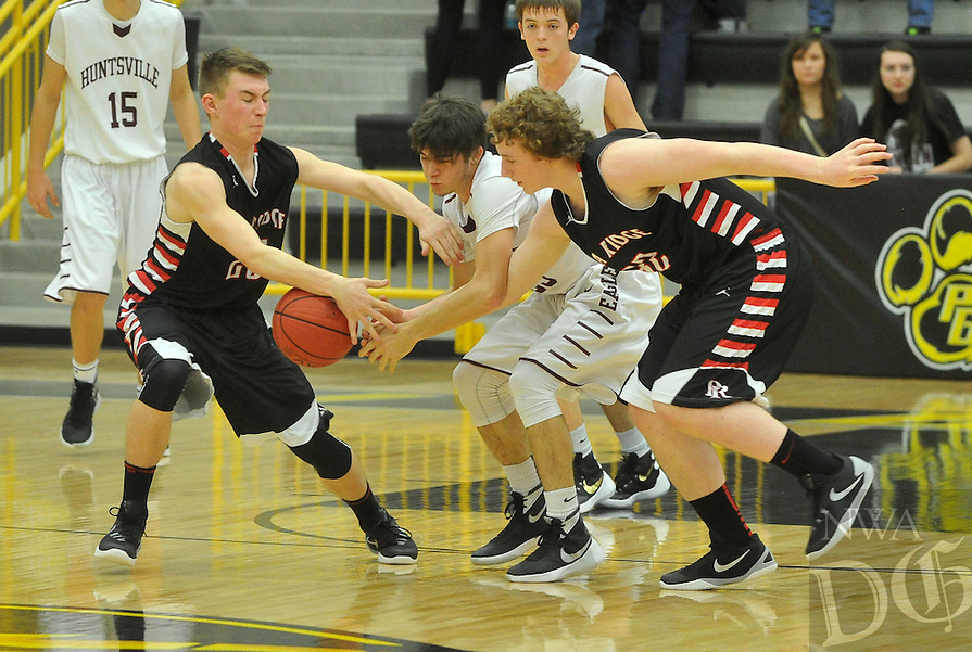 NWA Democrat-Gazette/MICHAEL WOODS &bull; @NWAMICHAELW<br /> Pea Ridge defenders Logan Johnson (25), Mikey Mahoney (32) and Huntsville's Kenton Yarbrough (23) fight for a loose ball during the boys 4A-1 District Tournament in Prairie Grove Saturday February 20, 2016.  Visit nwadg.com/photos to see more photographs from the game.
