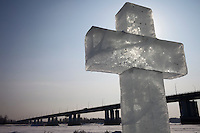 Barnaul, Altai Region, Siberia, Russia, 24/02/2011..A large ice Orthodox cross and ice chapel on the River Ob, remaining from January Epiphany celebrations when believers were baptised by total immersion in the frozen river.