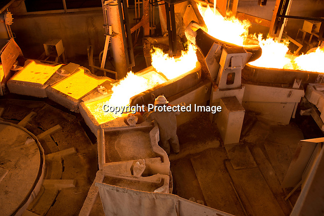MUFULIRA, ZAMBIA- JULY 6: An employee works at the copper smelter at Mopani Mines on July 6, 2016 in Mufulira, Zambia. The copper is trucked to ports such as Dar es Salaam, Tanzania & Durban, South Africa. Glencore, an Anglo-Swiss multinational commodity trading and mining company, owns about 73 % of Mopani mines, which produces copper and some cobalt. The mine employs about 15,000 people. Many people in the area are dependent of the mines and its subcontractors for work. (Photo by Per-Anders Pettersson)