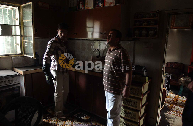 Palestinians inspect a burnt house after Israeli settlers burn  house Mahmood An najar in Boreen village in the West Bank city of Nablus.