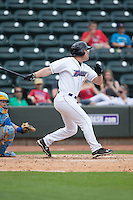 Nolan Early (15) of the Winston-Salem Dash follows through on his swing against the Myrtle Beach Pelicans at BB&T Ballpark on May 10, 2015 in Winston-Salem, North Carolina.  The Pelicans defeated the Dash 4-3.  (Brian Westerholt/Four Seam Images)