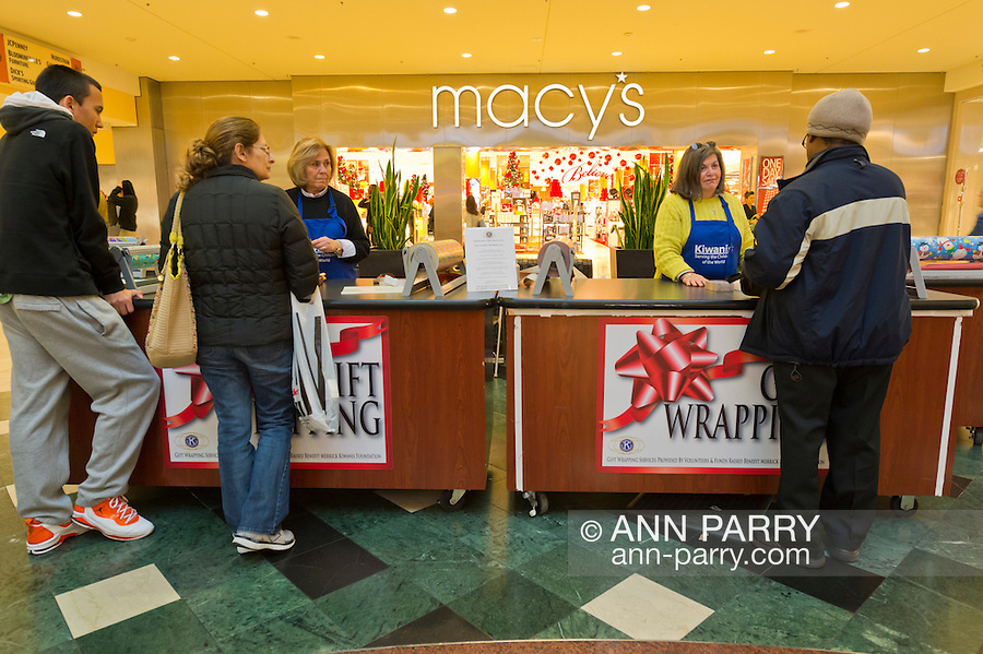 Dec. 12, 2012 - Garden City, New York, U.S. - Left to right, CAROLE METZGER of Plainview and LINDA SUSMAN of Merrick, are wrapping gifts to help Merrick Kiwanis Club, a community service group, raise funds to use for charity, at Roosevelt Field shopping mall, during the busy winter holiday shopping season. They were among members of Meadowbrook Women's Initiative helping at the Kiwanis booth at the major Long Island mall. Some ways Kiwanis helps the community are by providing food, clothing, and school supplies to those in need, sending children to Kamp Kiwanis, providing scholarships and hosting a Harvest Ball for senior citizens.