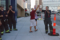 Kansas City, MO - Monday, June 16, 2014:  A USA soccer fans hi-fives several firemen after watching the USA vs. Ghana first round World Cup match at a public viewing in the Power and Light District of Kansas City, Missouri.