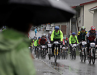 A group of riders leaving the starting point in Rena. The interest for mountain bike races has exploded in Norway the last few years, particularly with middle age affluent men. The biggest is called Birkebeinerrittet, or Birken, a race of 94,6 km and 14.500 participants, and was fully booked in 41 seconds. This years race proved to be hardest ever with constant rain and low temperatures.