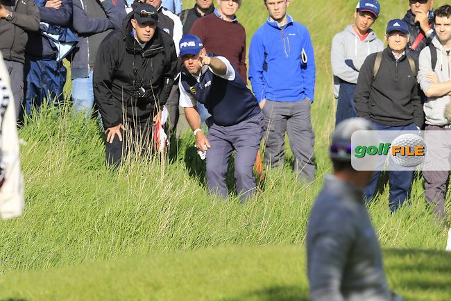 Lee Westwood (ENG) checks his line for his 2nd shot from the rough on the 17th hole during Thursday's Round 1 of the 2016 Dubai Duty Free Irish Open hosted by Rory Foundation held at the K Club, Straffan, Co.Kildare, Ireland. 19th May 2016.<br /> Picture: Eoin Clarke | Golffile<br /> <br /> <br /> All photos usage must carry mandatory copyright credit (&copy; Golffile | Eoin Clarke)