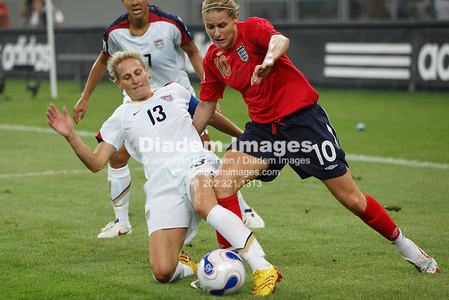 TIANJIN, CHINA - SEPTEMBER 22:  Kristine Lilly of United States (13) defends against Kelly Smith of England (10) during a Women's World Cup quarterfinal soccer match September 22, 2007 in Tianjin, China.  (Photograph by Jonathan P. Larsen)