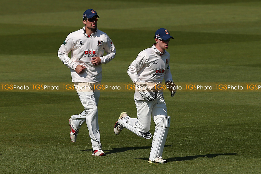 Alastair Cook (L) and Robbie White jog between overs during Surrey CCC vs Essex CCC, Specsavers County Championship Division 1 Cricket at the Kia Oval on 11th April 2019