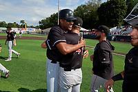 Batavia Muckdogs Lorenzo Hampton (left) hugs Evan Brabrand (41)  during a NY-Penn League game against the Auburn Doubledays on September 2, 2019 at Falcon Park in Auburn, New York.  Batavia defeated Auburn 7-0 to clinch the Pinckney Division Title.  (Mike Janes/Four Seam Images)