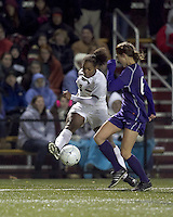 "Boston College forward Natalie Crutchfield (9) crosses the ball as University of Washington midfielder Lindsey Bos (6) defends. In overtime, Boston College defeated University of Washington, 1-0, in NCAA tournament ""Elite 8"" match at Newton Soccer Field, Newton, MA, on November 27, 2010."