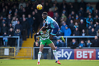 Aaron Pierre of Wycombe Wanderers climbs over Omar Sowunmi of Yeovil Town during the Sky Bet League 2 match between Wycombe Wanderers and Yeovil Town at Adams Park, High Wycombe, England on 14 January 2017. Photo by Andy Rowland / PRiME Media Images.