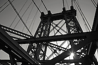 Williamburg Bridge connecting Brooklyn to the Lower East Side of Manhattan. Morning silhouettes.