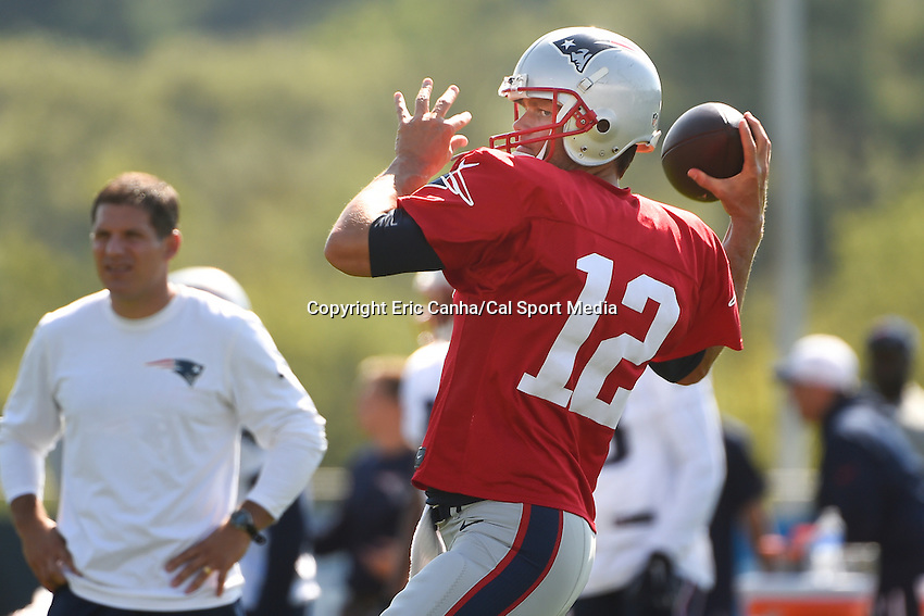 August 1, 2015, Foxborough, MA - New England Patriots quarterback Tom Brady (12) throws a pass during the New England Patriots training camp held on the practice field at Gillette Stadium. Eric Canha/CSM