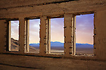 Through The Windows Of A Crumbling Structure Overlooking The Amargosa Valley At Rhyolite Nevada, An Abandoned Town Near Death Valley, USA